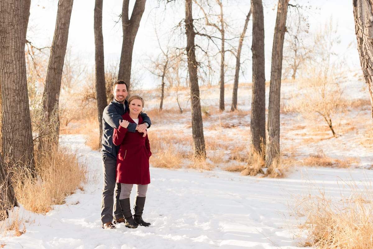Engagement portrait in the snow at Cherry Creek State Park in Aurora, CO.