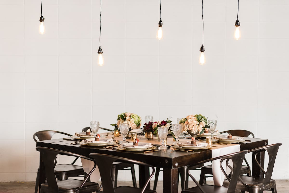 Styled wedding table at The Hangar at Stanley in Aurora, CO