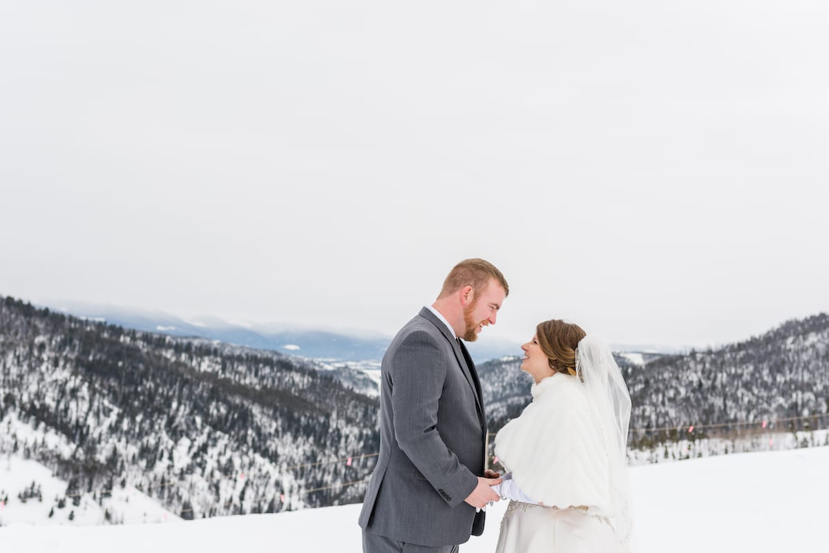 Bride and groom on winter mountain