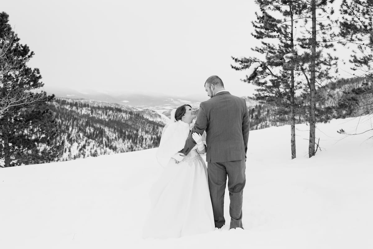 Bride and groom in snow black and white