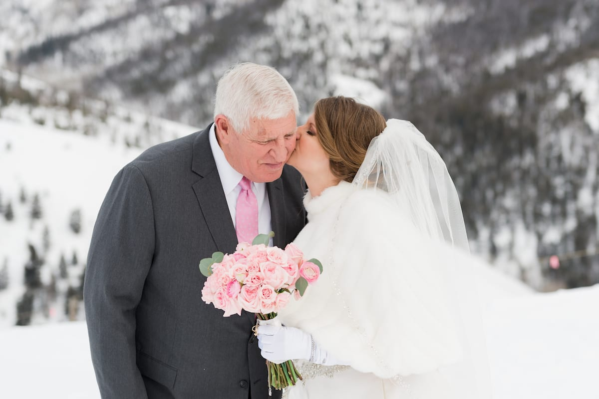 Bride kisses her father's cheek
