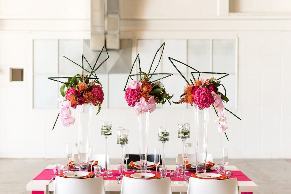 Three tall pink floral centerpieces