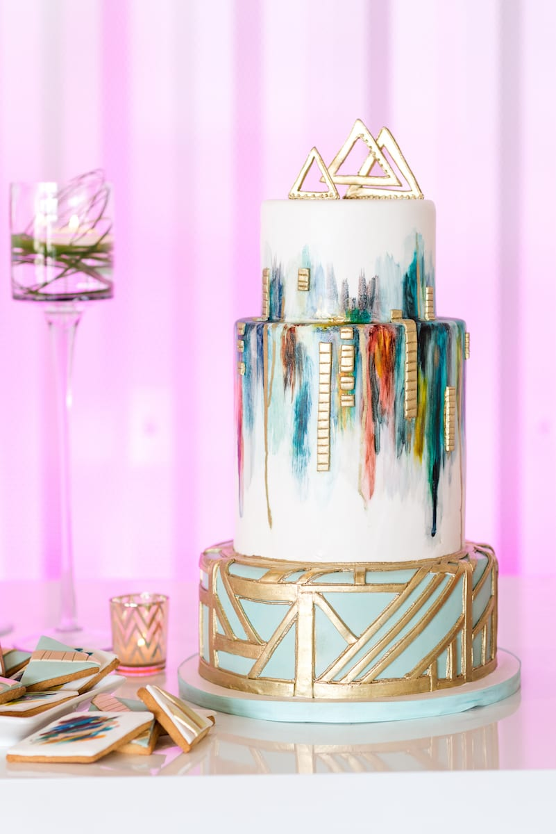 Watercolor inspired wedding cake with gold elements