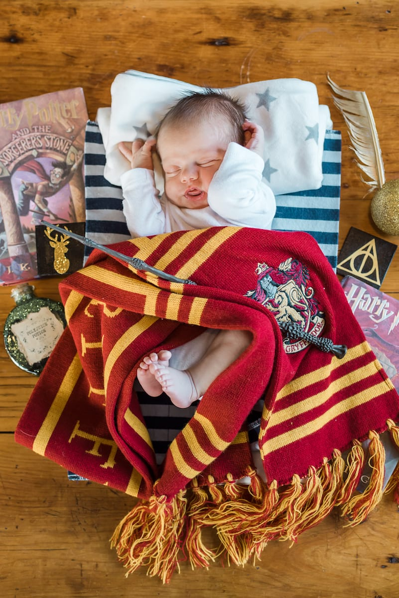 newborn amongst harry potter memorabilia