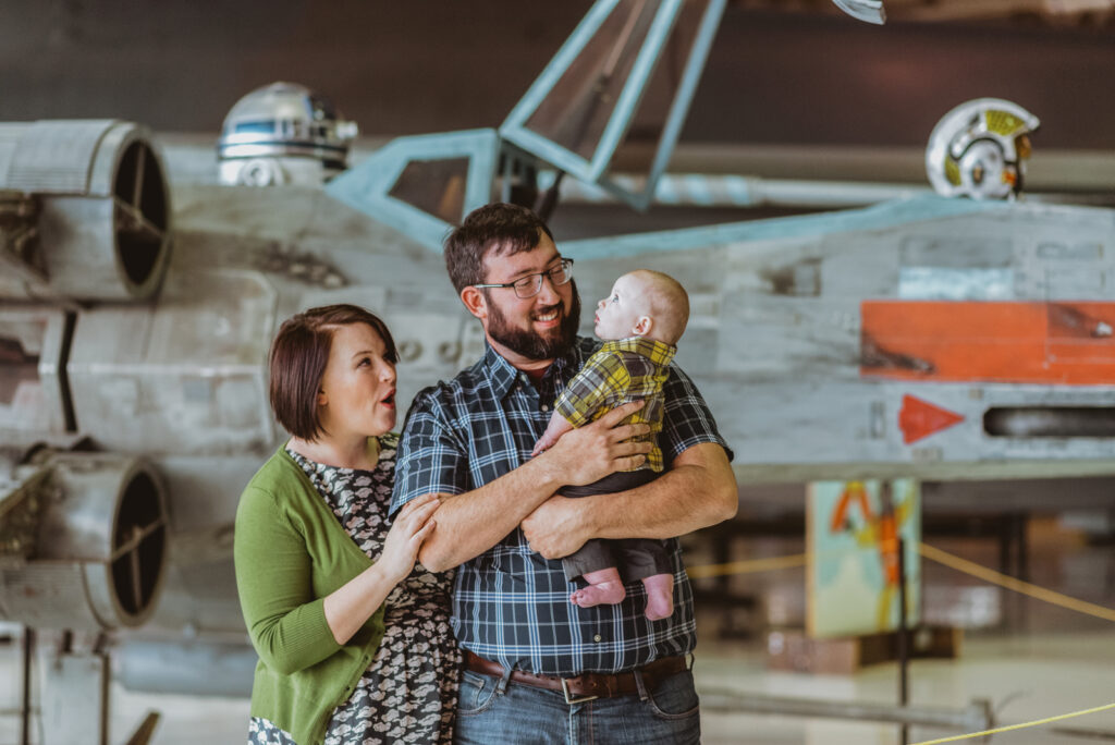 Wings Over The Rockies indoor aircraft museum edgy fun adventurous family picture   From the Hip Photo Denver Colorado portrait photography