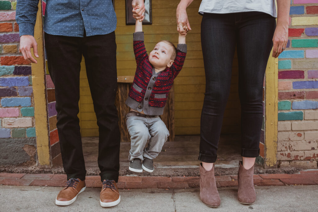 Pearl Street Boulder mall outdoor shopping fun candid adventurous family picture   From the Hip Photo Denver Colorado portrait photography