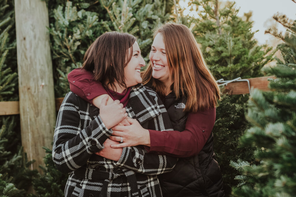 Pumpkin Patch Christmas Tree Farm outdoor holiday activity candid fun romantic engagement picture   From the Hip Photo Denver Colorado portrait photography
