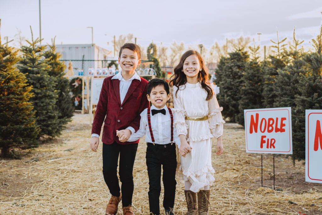 Pumpkin Patch Christmas Tree Farm outdoor holiday activity candid fun loving family picture   From the Hip Photo Denver Colorado portrait photography