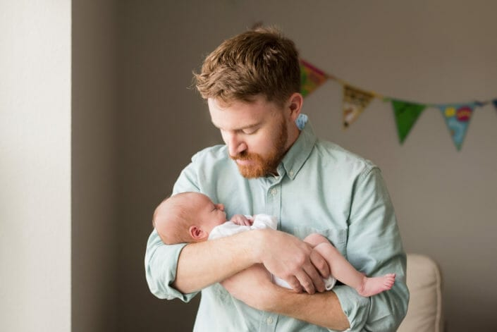 Colorado father with newborn infant baby photo