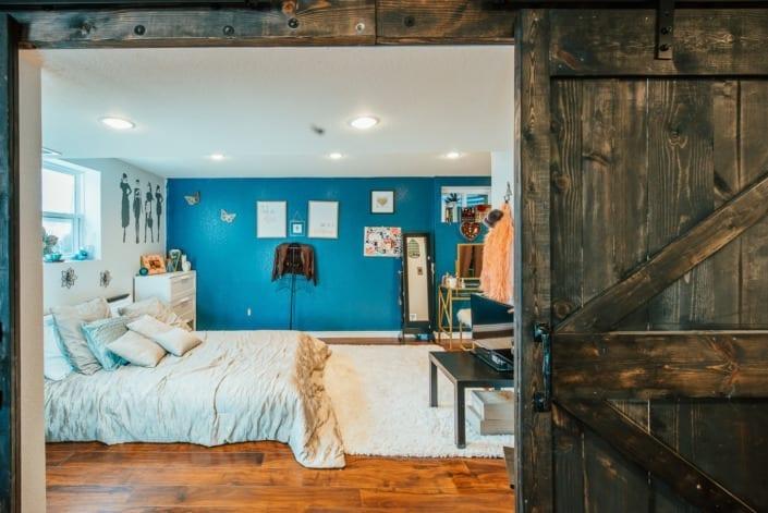 Rustic Bedroom with Barn Door Photo | Colorado Real Estate Photographer