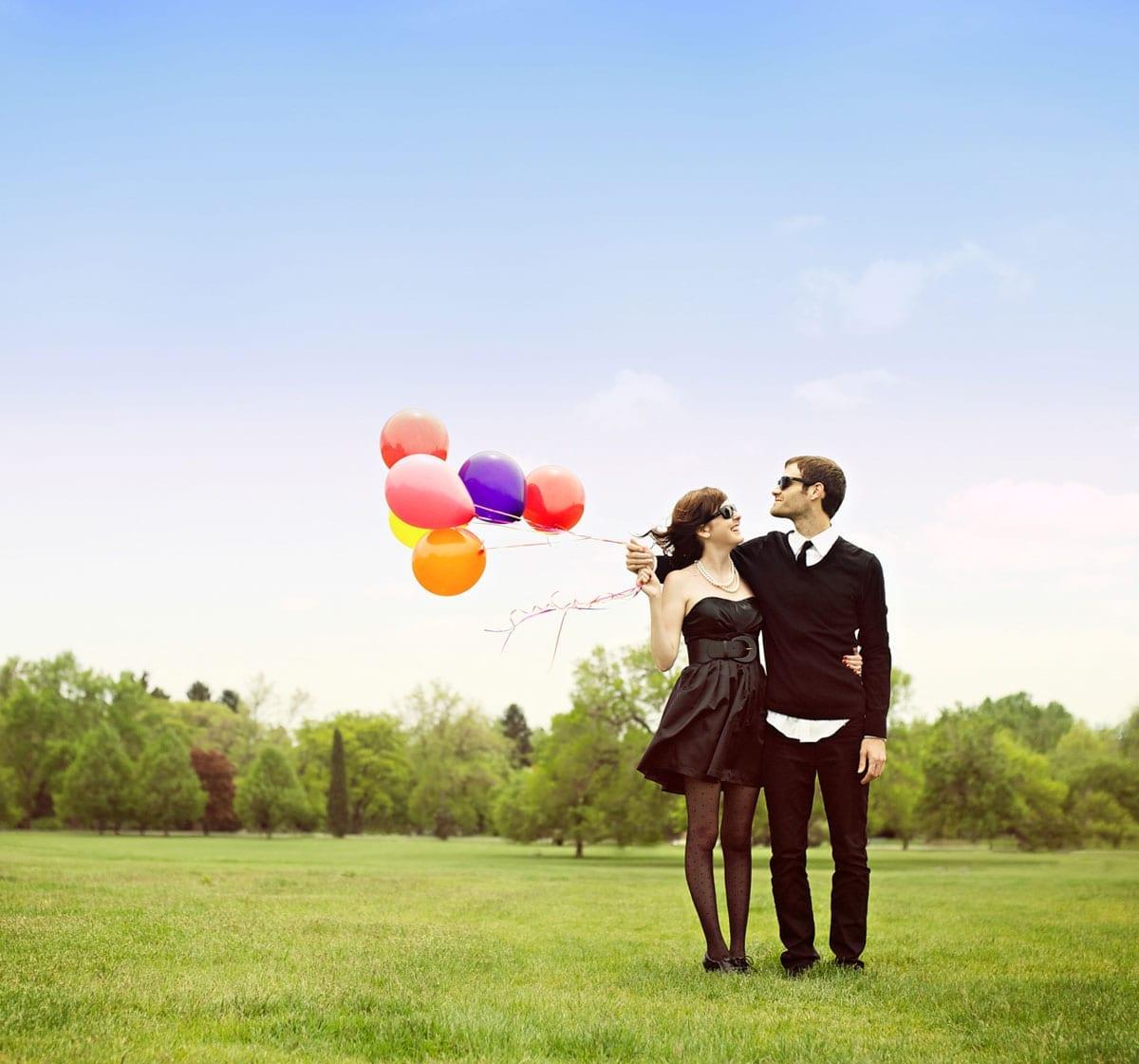 Colorful fun wedding photos   Bride and groom with balloons  Colorado Wedding Photographers